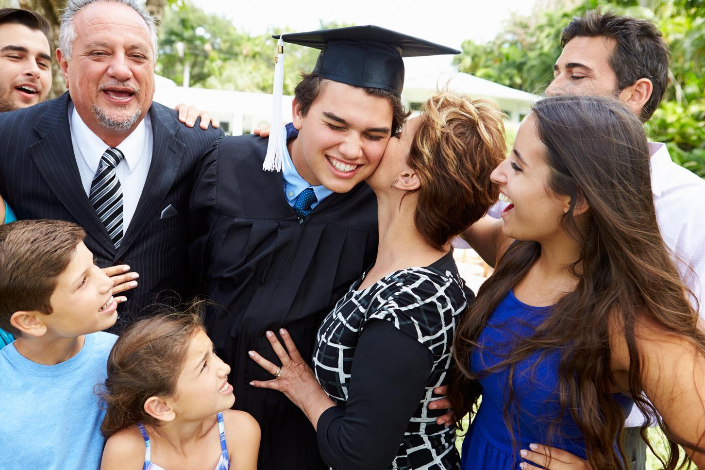 Student and his family celebrating graduation