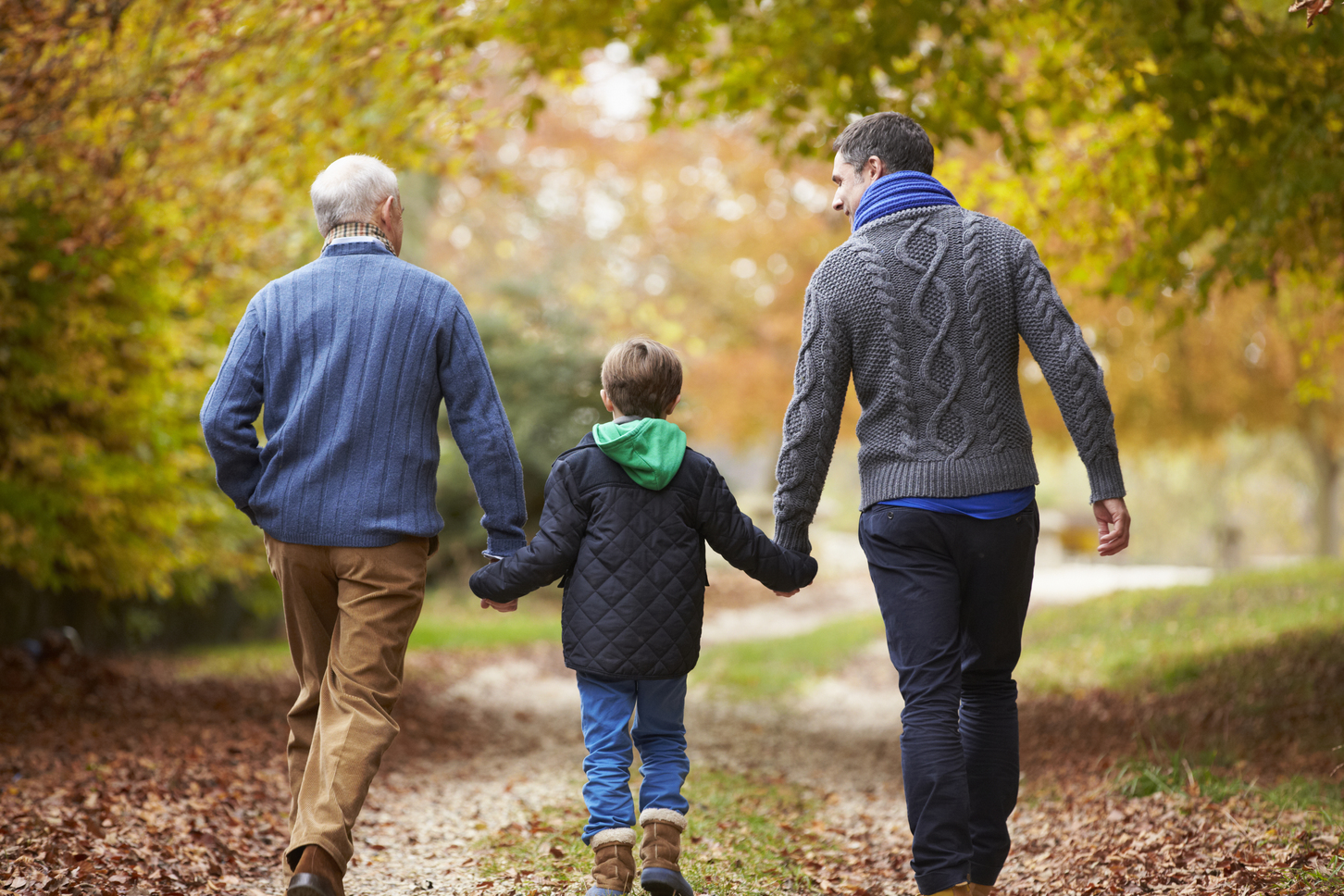 Multigenerational family walking on a path