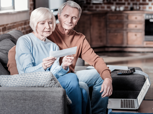 retired couple reviewing document